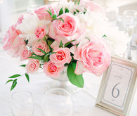 Pink rose centerpiece and silver table number