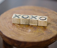 Wedding rings on wooden xoxo blocks