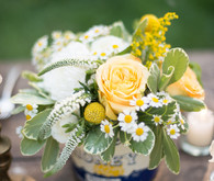 Yellow and white floral centerpiece
