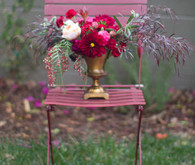 Gold vase with pink floral centerpiece