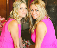 Bridesmaids in bright pink dresses