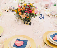 Outdoor light pink and blue place setting with heart favor