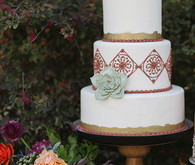 Spanish inspired white cake with green floral decor