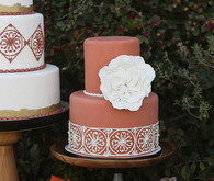 Spanish inspired deep red cake with white floral decor