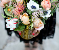 Peonie and air plant centerpiece with gold vase