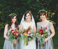 Bridesmaid in grey dresses with colorful bouquets