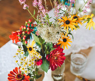 Daisy and colorful flower centerpieces