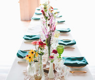 Camp themed colorful wedding tablescape