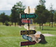 Colorful camp themed wedding signage