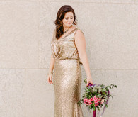 Gold wedding dress with pink bouquet