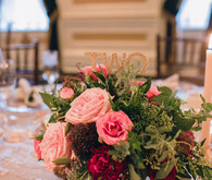 Pink and red centerpiece with gold table number