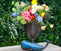 Bronze centerpiece with colorful flowers