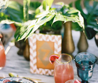 Tropical, summer inspired wedding place setting and table number