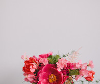 Pink anemones with gold vase