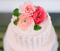 Light pink cake with flower cake topper