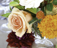 Fall wedding wood with deep colored centerpiece