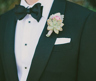 Succulent boutonniere and black bow tie