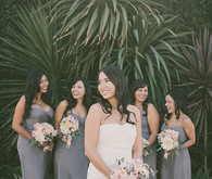 Grey bridesmaid dresses with light pink bouquets