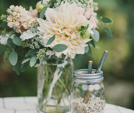 Rustic floral decor on guestbook table