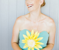 Bridesmaid with DIY yellow paper flower bouquet