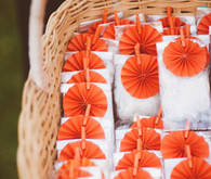 Wedding favors with orange paper flowers