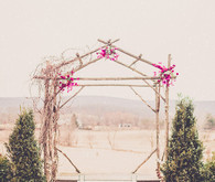 Rustic wooden ceremony arch