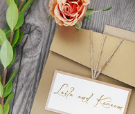 Cream and white invitation with twine