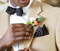 Creme suit with boutonniere