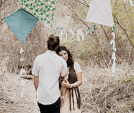 Bohemian inspired engagement portrait with kite decor
