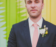 Groom with pink tie and boutonniere