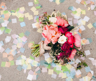 Confetti with pink and red bouquet