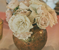 Gold vase with white flowers