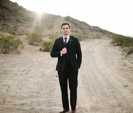 Desert wedding groom portrait