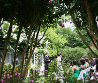 Whimsical garden summer wedding ceremony