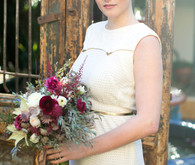 Vintage inspired bride with plum bouquet
