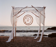 Bohemian beach wedding altar