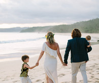 Beach wedding family portrait