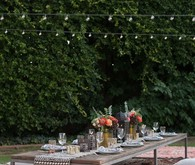 Eclectic outdoor dinner party tablescape