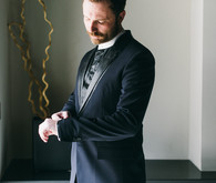Dark blue grooms suit