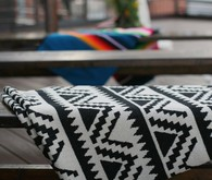 Wooden benches draped in serape blankets