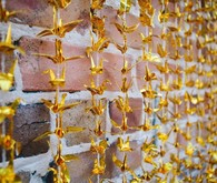 Gold paper crane ceremony backdrop,