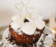 white cupcakes with heart toppers
