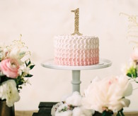 feminine pink first birthday cake