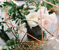 Copper + green industrial modern wedding centerpiece