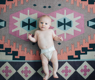 boho rug and baby portrait