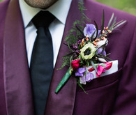 Purple grooms suit