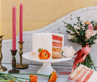 White and orange wedding cake