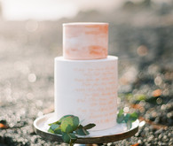 Copper and white wedding cake