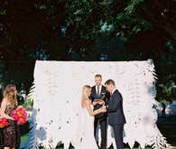 Tropical paper flower ceremony backdrop