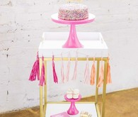 pink cake stand and bar cart